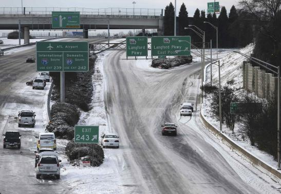 Abandoned cars litter the roadway on the Southbound Connector due to a snow storm in Atlanta, Georgia