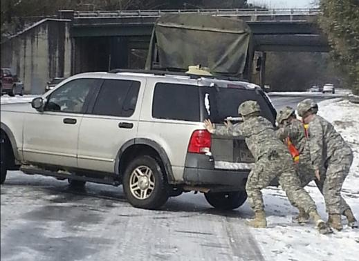Handout of Georgia Army National Guard assisting stranded motorists following a rare ice storm in Atlanta