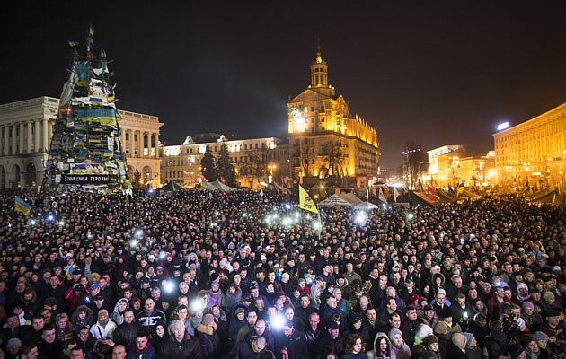 Crowds gather to watch new ministers of the Ukrainian government being presented at Independence Square in Kiev, Ukraine.